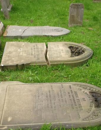 Headstones that were knocked down by vandals in Flaybrick cemetery.