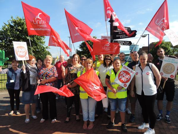 Workers from Wirral's leisure services strike outside Europa Pool in Birkenhead.