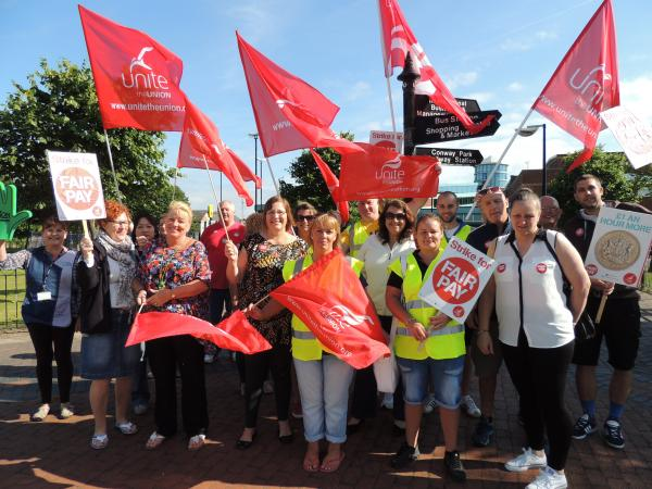 Flashback: Workers on strike at Europa Pools in Birkenhead earlier this month