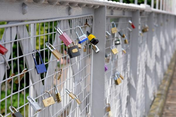 Love Locks waiting to be reclaimed from Queens Park Suspension Bridge.