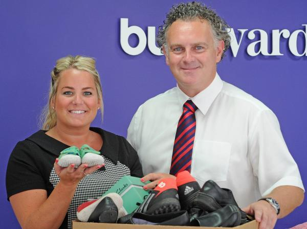 Vikki Syvret and Michael Ward with the donated shoes.