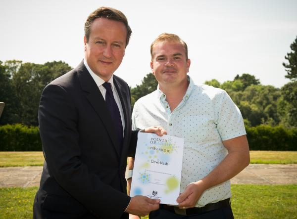 Prime Minister David Cameron presents the Point of Light award to Dave Nash.