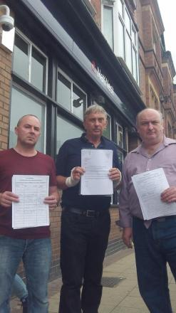 Gary Faulkner, Tony Pritchard and Ian Forber with petitions outside NatWest in New Brighton.