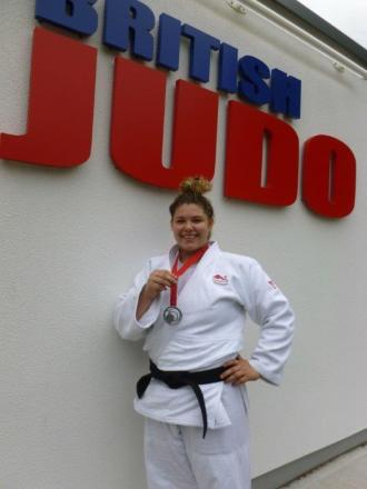Jodie Myers proudly displays her silver medal