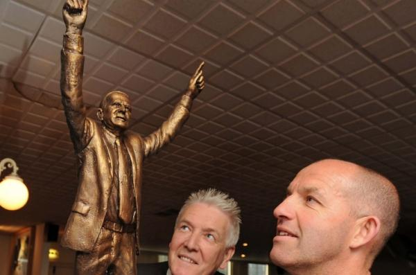 Sculptor Tom Murphy and Tranmere Supporters' Trust chairman Ben Harrison look at the maquette for Johnny King statue. Picture: TRST