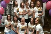 Abbie Major, centre, surrounded by her school friends who cut their hair for charity