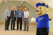 Danny Ambrose, John Nozedar, Mark Jones and Paul Rushbrook hand the centre over to hospice mascot John Bear in the centre in June. Picture: Paul Heaps