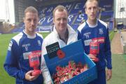 Rovers midfielders Jason Koumas and Marc Laird with Pete Dunning at the launch of Poppy Appeal at Prenton Park this morning. Picture: Craig Manning