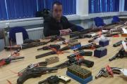 Detective Chief Inspector Tom Keaton with some of the 126 weapons handed in. Picture: Craig Manning