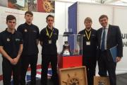 PICTURE: Some of the apprentice team with the HMS Liverpool bell and Philip Dunne MP at the event in London