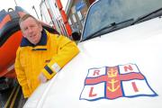 Senior helmsman Dave Lowe with vehicle used to take bags to tip. Picture: Paul Heaps