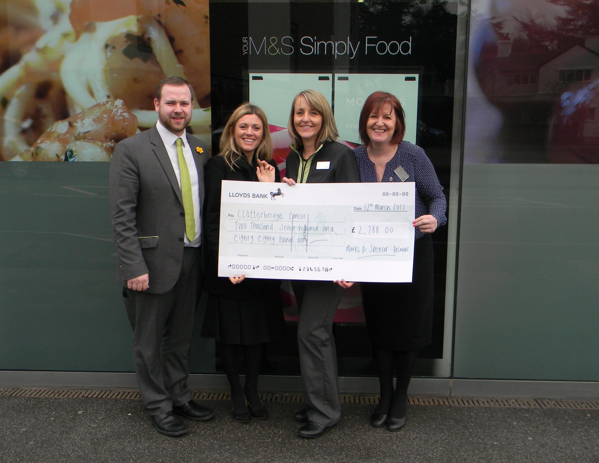 Louise Beach and Celia Roberts with staff from M&S in Heswall