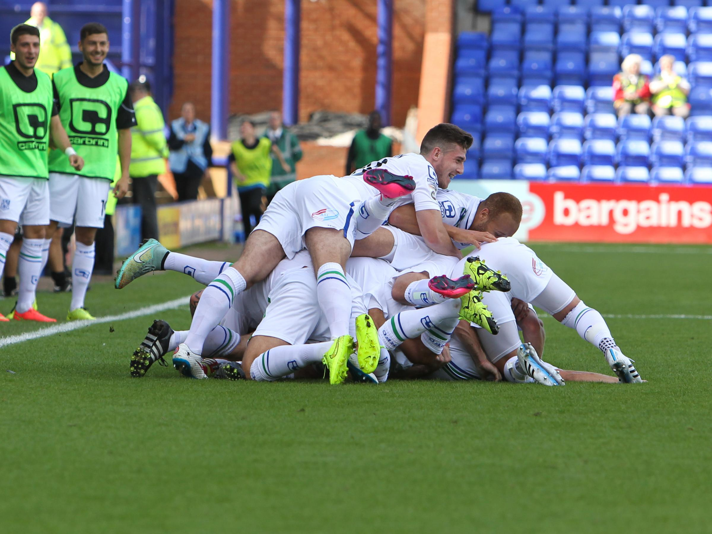 Celebrations after Jay Harris hits the net for Rovers