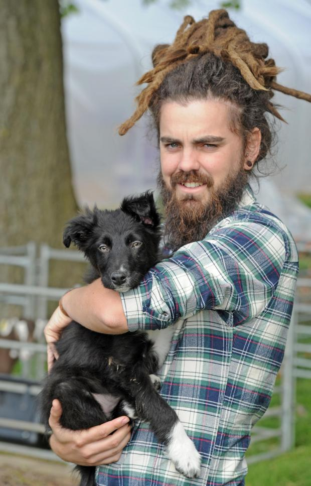 Pete Fearon with Bebington High's sheep dog Leif. Picture by Paul Heaps.