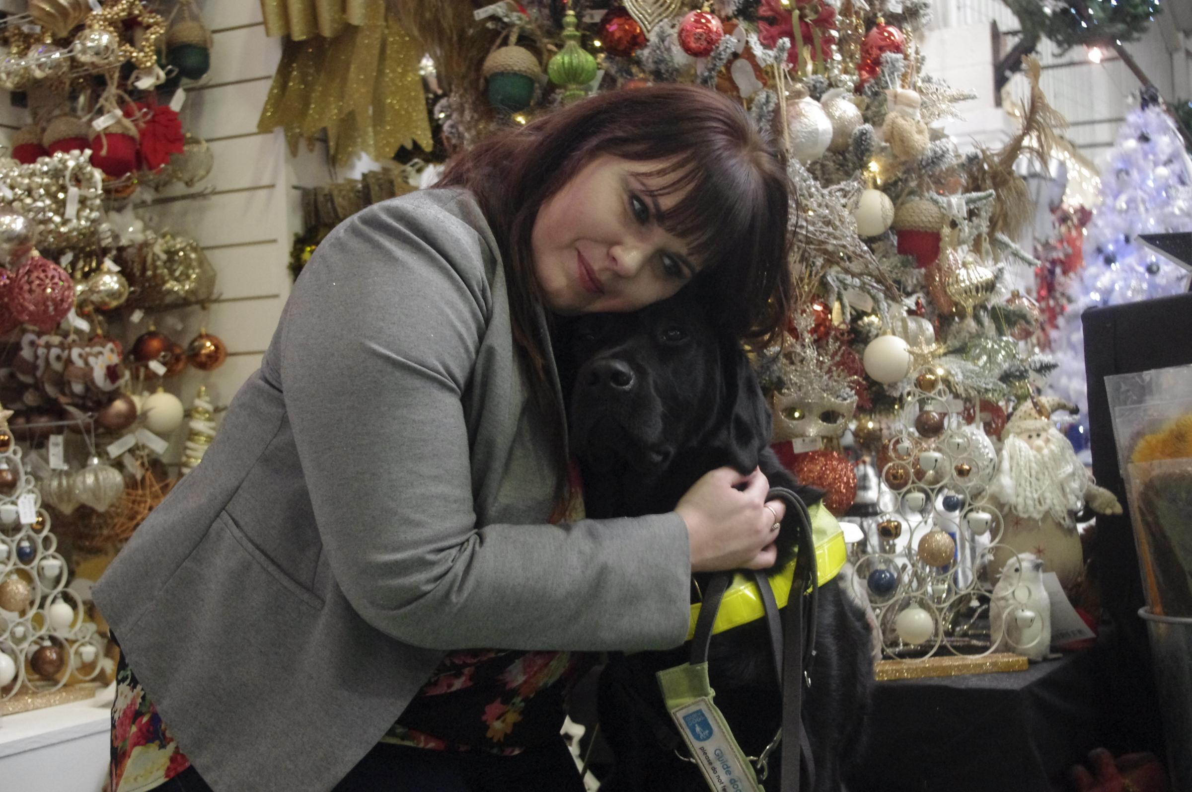 Vicky and guide dog Dickens.