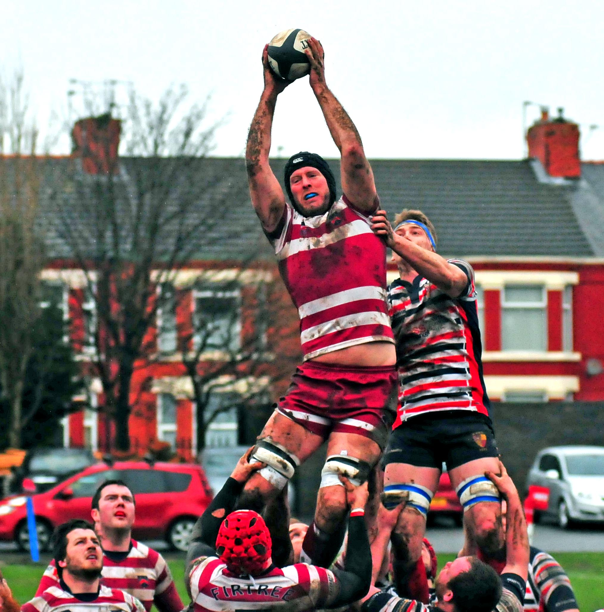 Wirral's Ryan Sterad securing good line-out ball against Birkenhead Park in a feisty game. Picture by Steve Billington