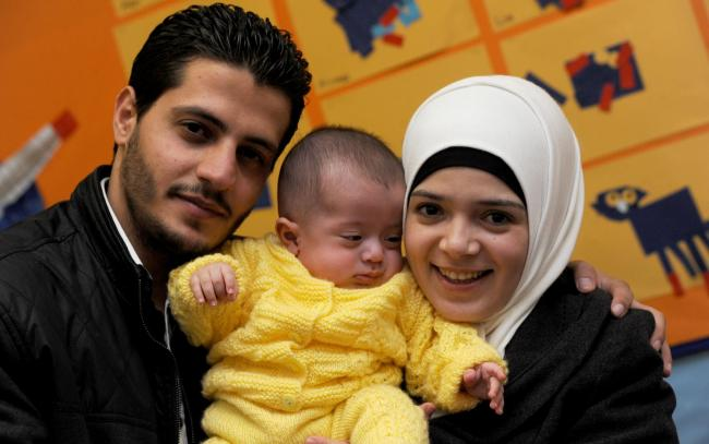 Syrian refugees Ali and Abeer and their son Baraa who have moved to Wiltshire