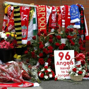 Wirral Globe: Flowers are placed at the Hillsborough memorial plaque during the Hillsborough 27th Anniversary Memorial Service at Anfield, Liverpool