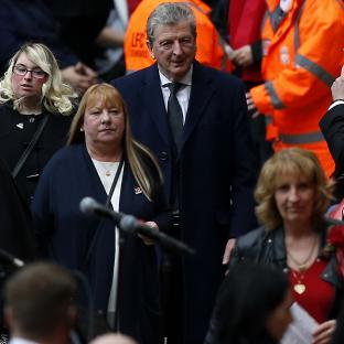 Wirral Globe: England manager Roy Hodgson arrive for the last memorial service to be held at Anfield, Liverpool, to mark 27 years to the day since the tragedy claimed 96 lives