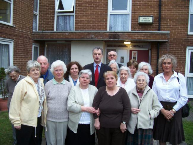 CONCERN: Residents of Hoose Court in Hoylake with Wirral West MP Stephen Hesford