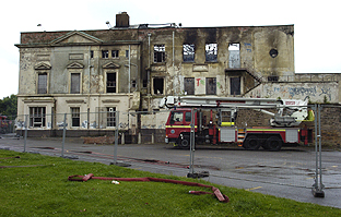 DESTROYED: Two floors of Grade Two-listed Liscard Hall were demolished after the fire on Monday morning