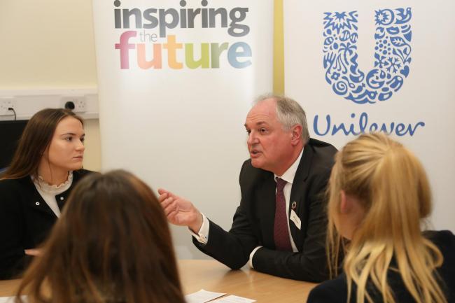 Chief executive of Unilever Paul Polman with a group of students at the event.