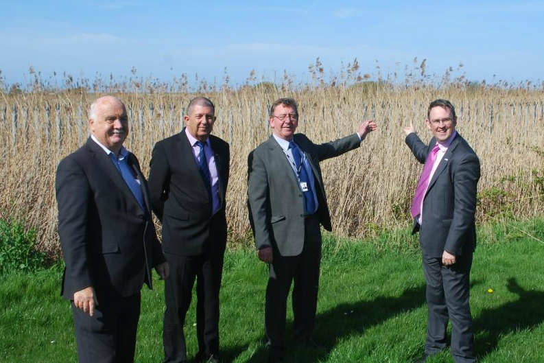 Rail Minister Paul Maynard MP with ward councillors Chris Blakeley, Steve Williams and Bruce Berry at the site of proposed Town Meadow Station in Moreton