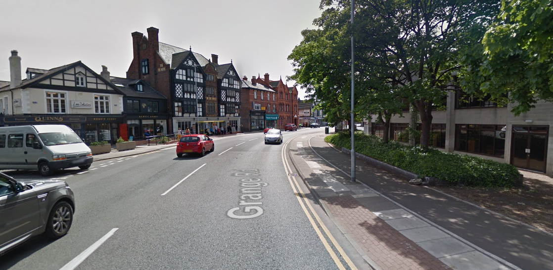 Police road closures after bricks fall from building in West Kirby