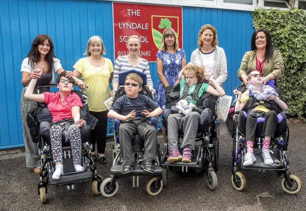 FLASHBACK: From Left: Dawn Hughes and daughter Ellie, Jan Pickin, Chrissie Brie and son Alex, headteacher Kim Owen, Zoe Anderson and daughter Lily, Emma Leadbetter and daughter Neave following the leavers' assembly in July 2016. Picture: Craig Manning