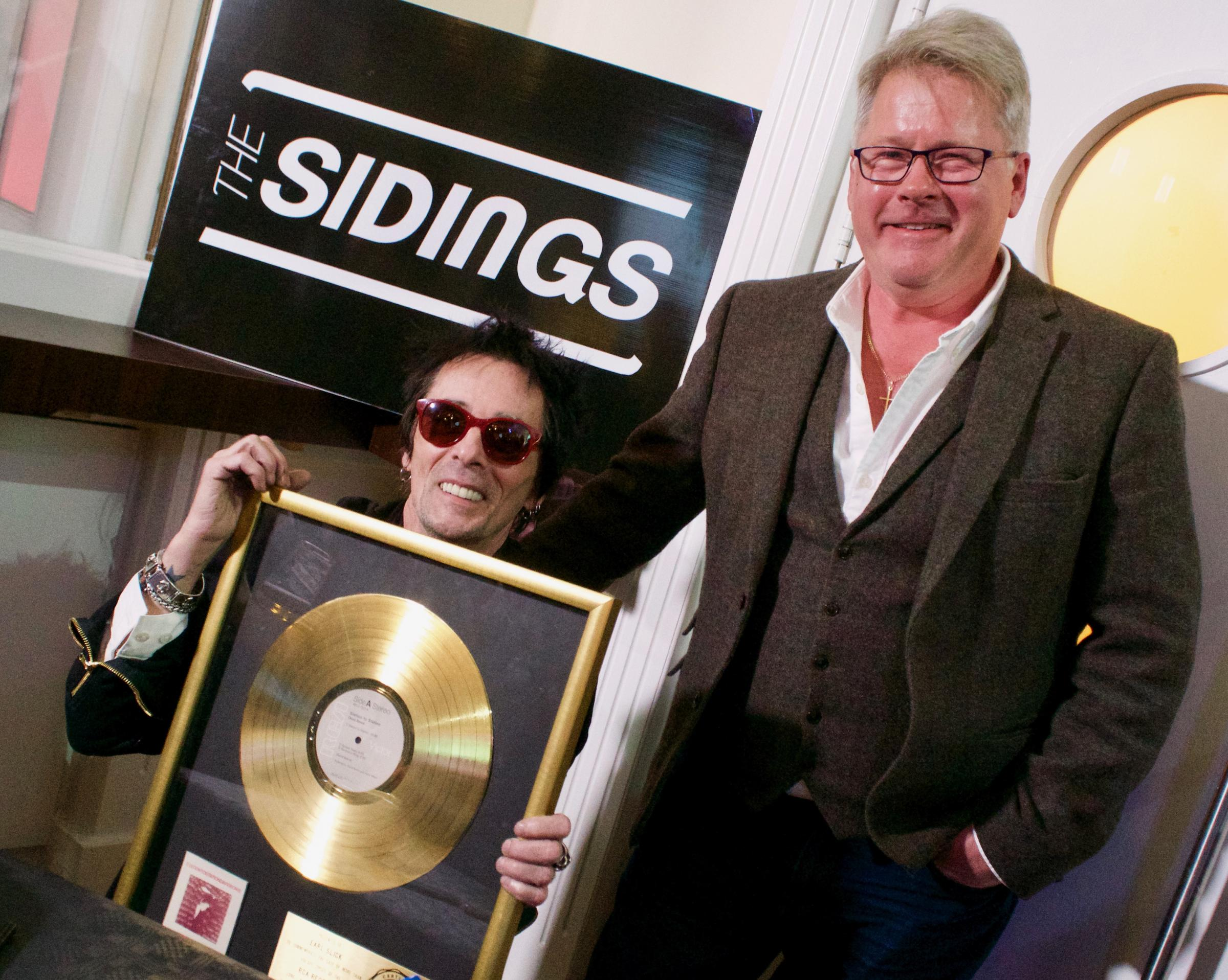 Earl Slick and Paul Häggqvist with the gold disc. (Picture: Colin Bailey @ Mediastir)
