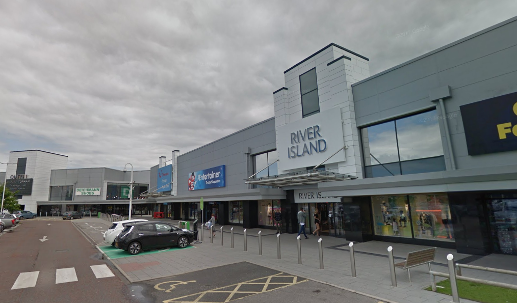 The woman was walking near to River Island at the Coliseum Shopping Park