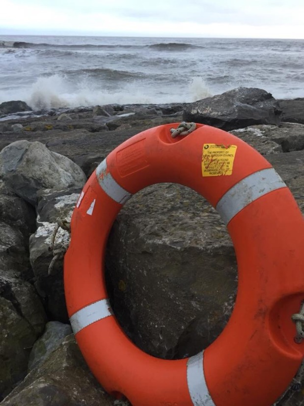The Wirral lifebuoy was found sitting on the rocks of a beach in South Wales