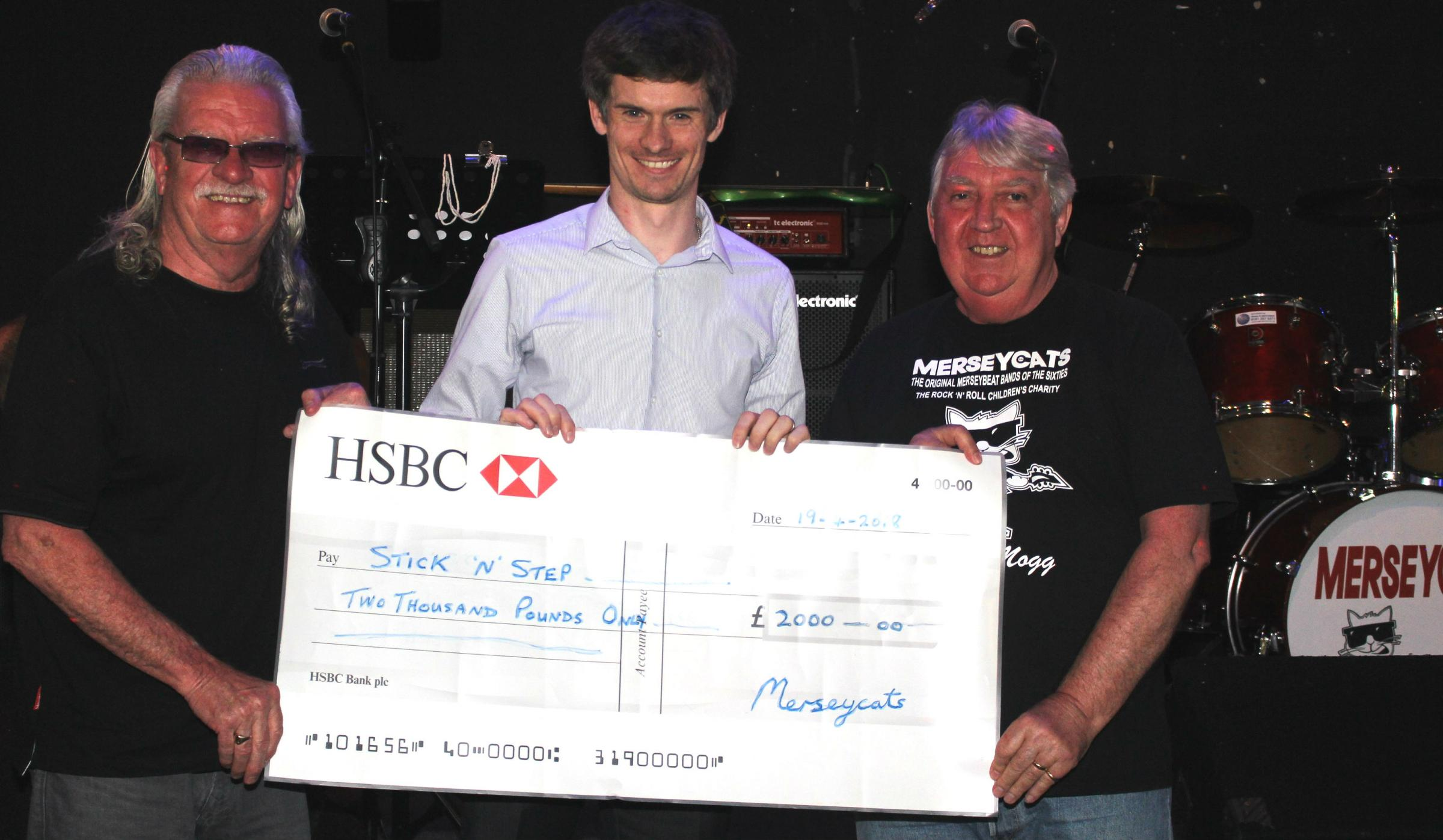 Left to right: Norman Petherbridge (Merseycats chair), Matt Meaney (Stick'n'Step development manager and Ronnie Hodge (Merseycats secretary) with Stick'n' Step cheque