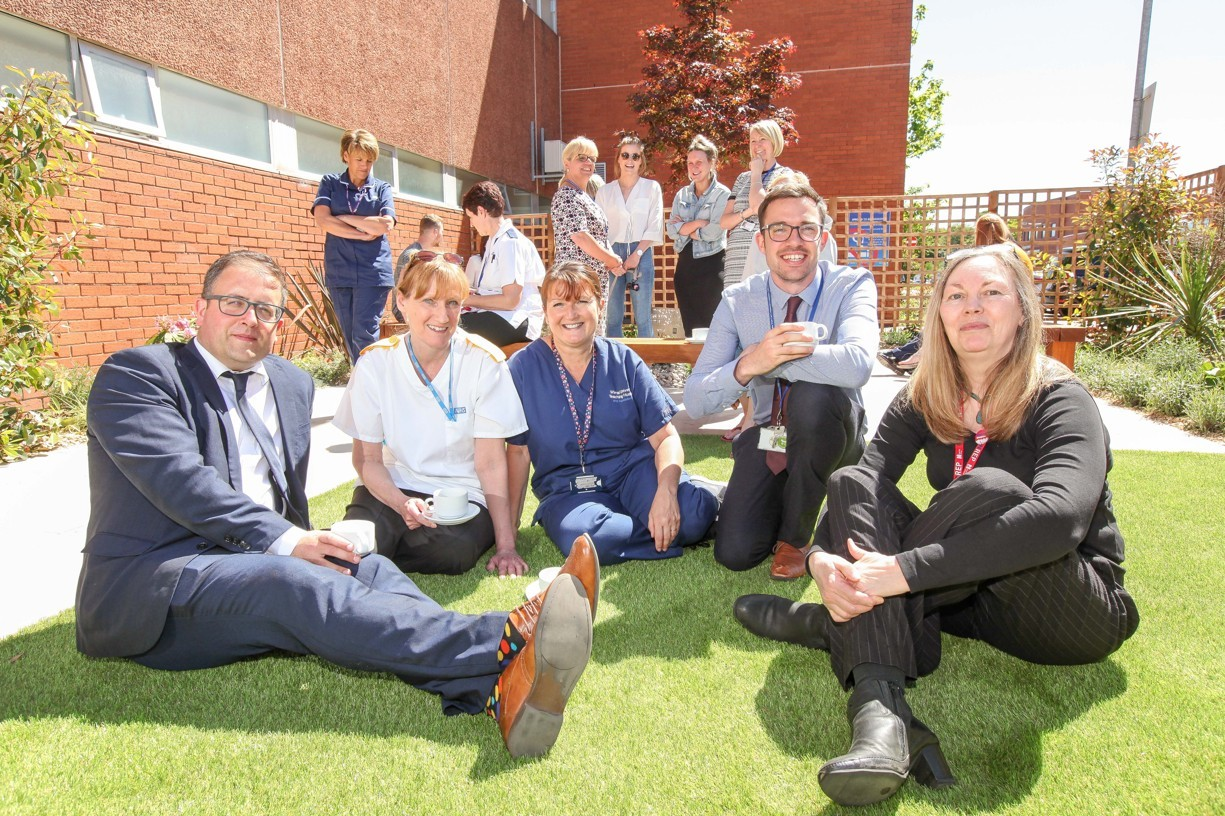 Arrowe Park Team Gary Price, Anne Broster, Kathy McCormack, Graham Dawson and Sue Kenny relax in the new garden