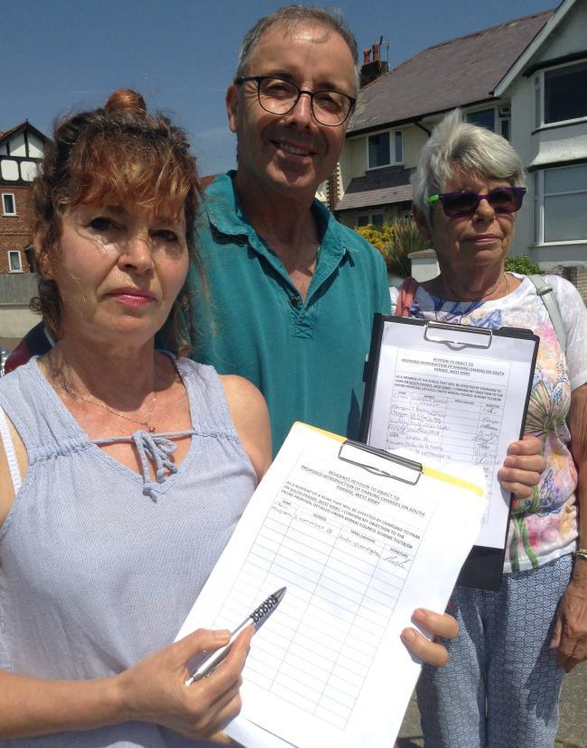 Ruth Trout, Simon Trout and Christine Thompson with petitions against planned parking charges on South Parade in West Kirby. Picture: Craig Manning