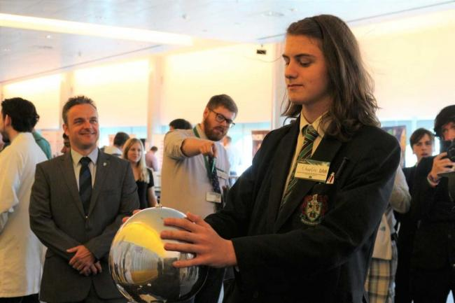 Mosslands student Charlie Dodson, 15, tests one of the exhibits at symposium