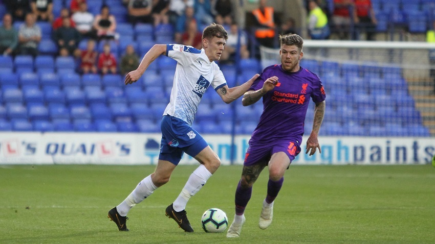 Ben Tollitt beats Alberto Moreno during the pre-season friendly match between Tranmere Rovers and Liverpool at Prenton Park. Picture: Richard Ault