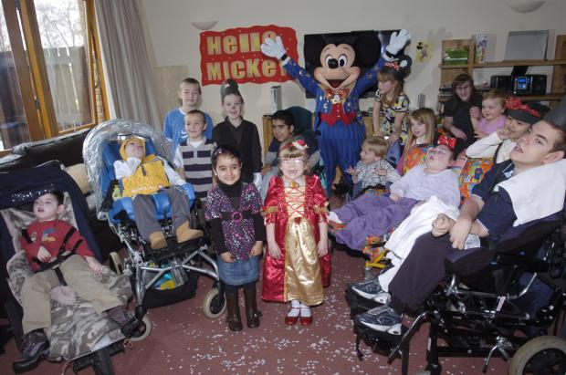 Mickey with children at Claire House