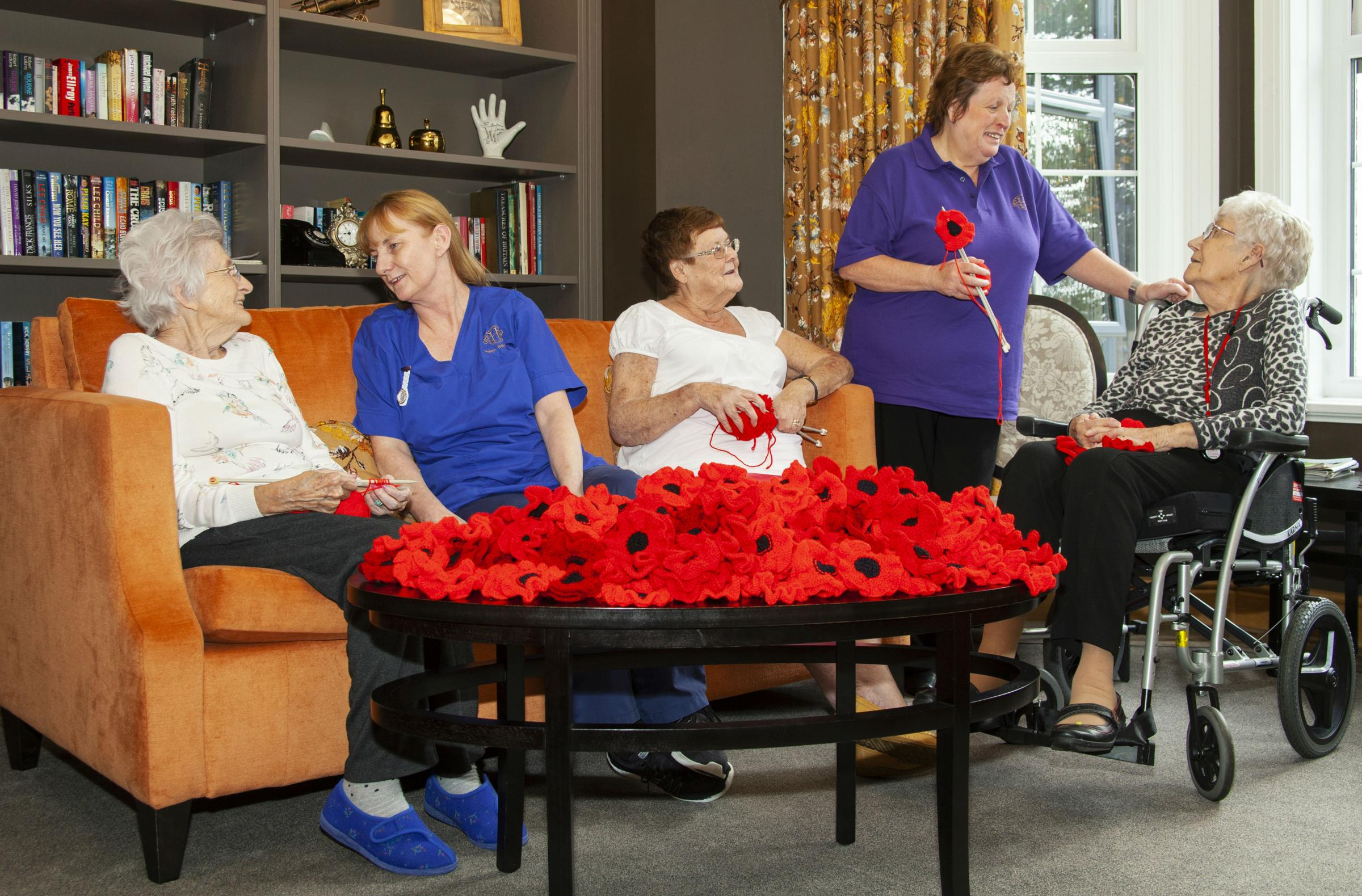 Residents and staff at the Hazlewell care home celebrate their handmade poppies