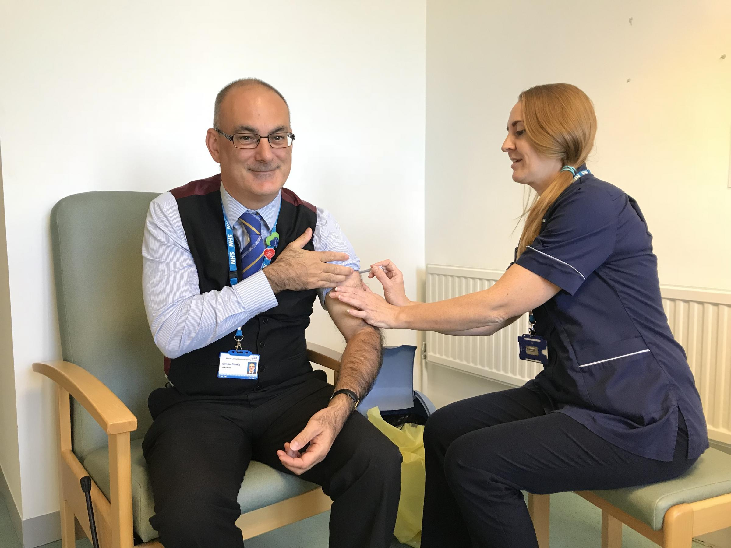 Simon Banks, Chief Officer of NHS Wirral CCG and Wirral Health and Care Commissioning gets his flu jab