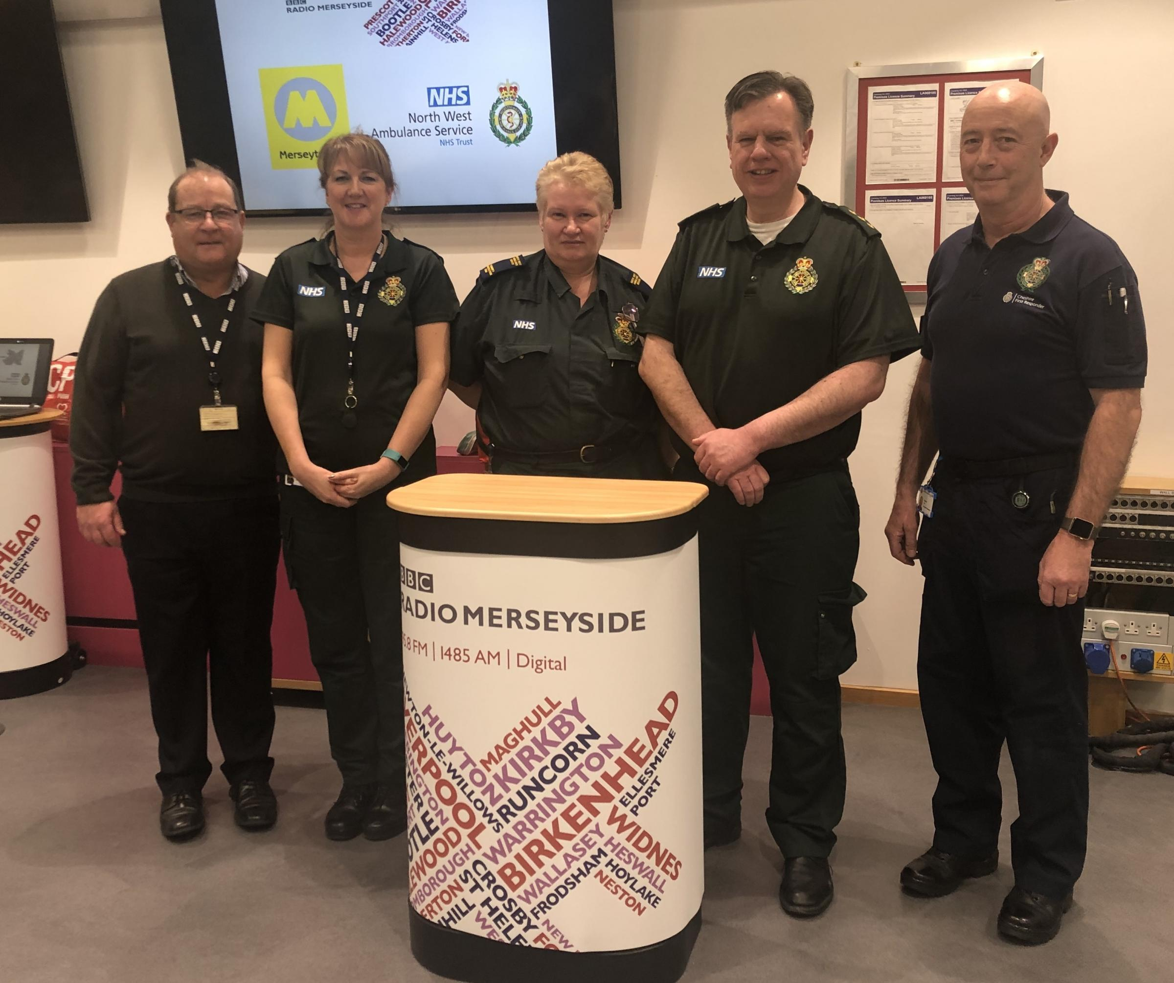 (Left to right) ) Andy Ball, Senior Broadcast Journalist for BBC Radio Merseyside joins the Community Resuscitation Training from North West Ambulance Service at the first CPR training session for the Mersey Heartbeats campaign