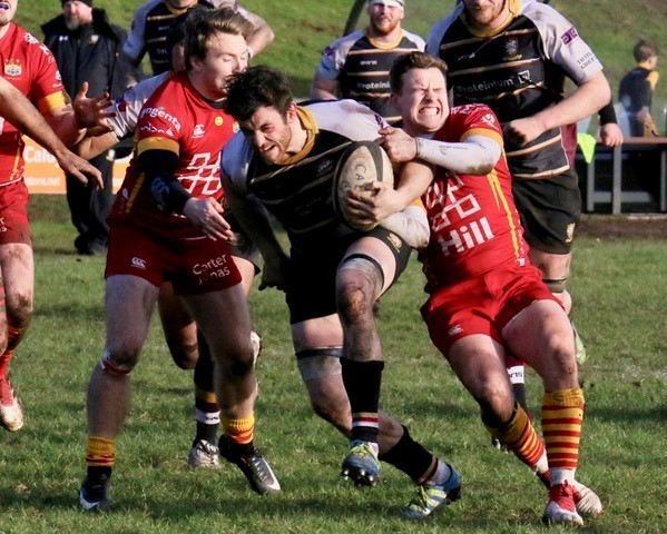 JJ Dicinson in action for Caldy against Cambridge. Picture: Derek Salisbury