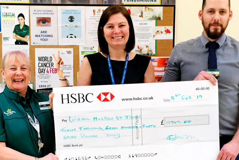 Julia Evans, fundraising manager at Wirral Hospice St John's receives the generous donation of £12,747.00 from Ruth Gibson, community champion for New Brighton Morrisons and deputy store manager Rob Bonner.