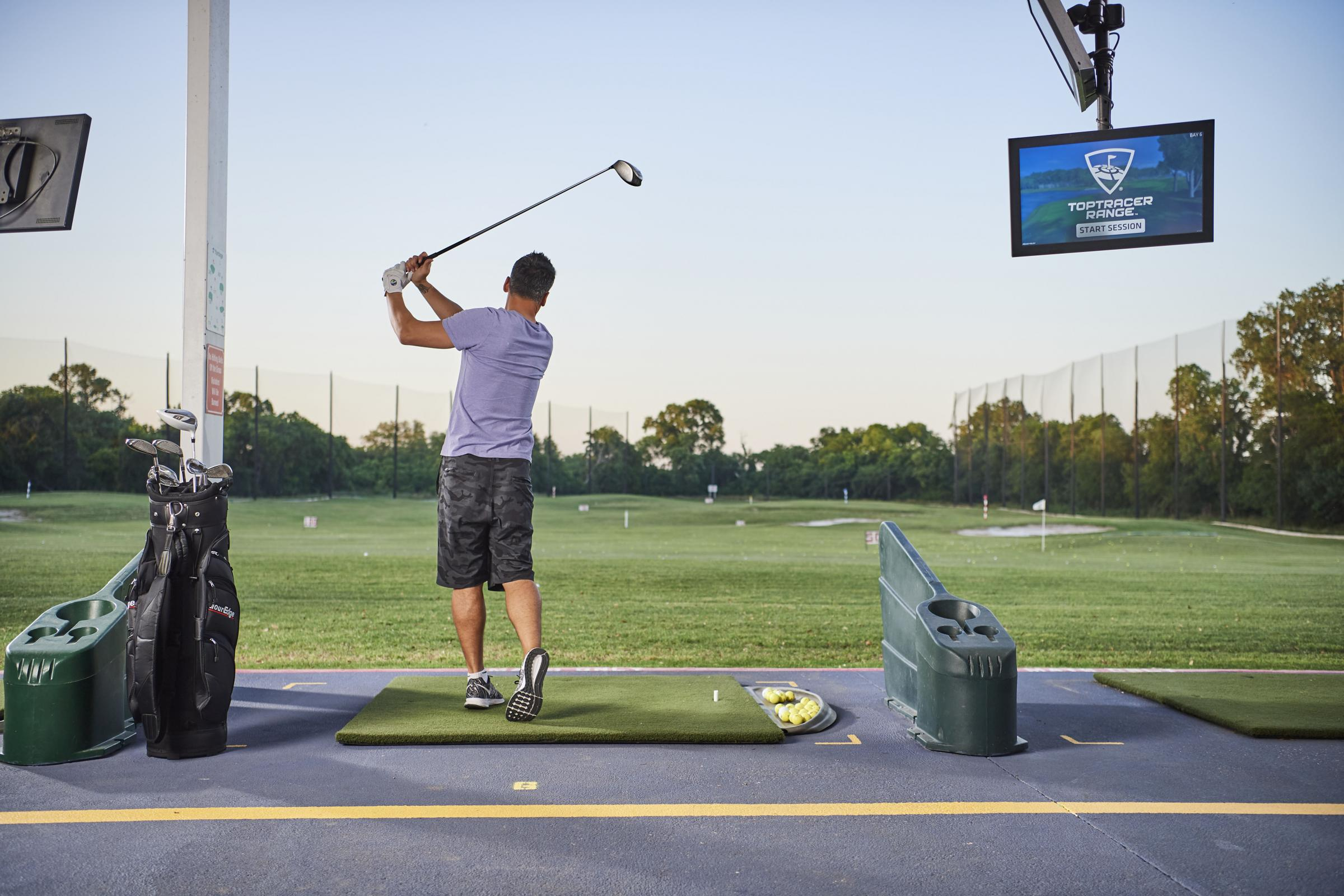 The new Toptracer Range software allows keen golfers to play against family and friends on a virtual course