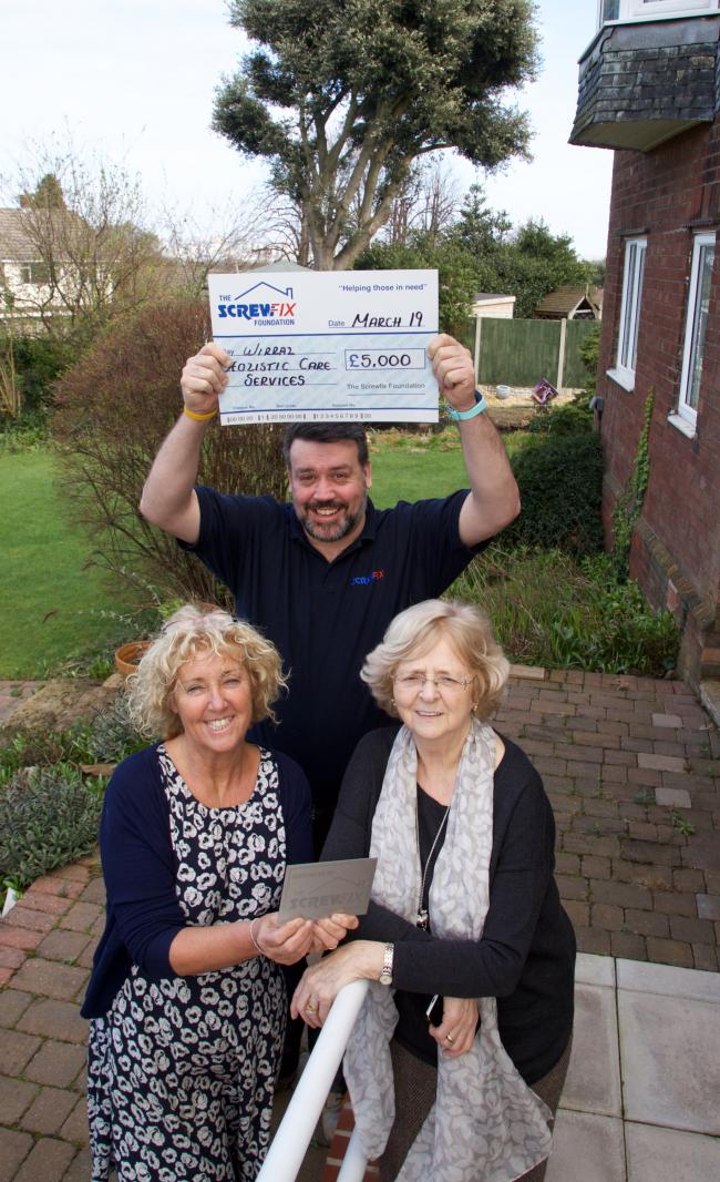 (Left to right) Wirral Holistic Care Outside  Patsy Hummerston (Nurse) Dave Bergin (Screwfix) and Dorothy Crowther CEO