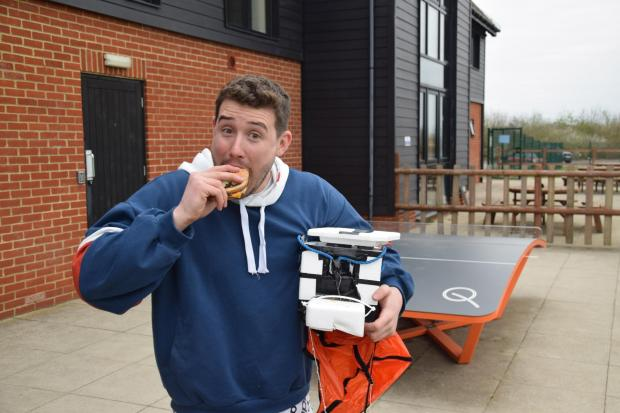 Wirral Globe: Tom Stanniland takes a bite of the burger