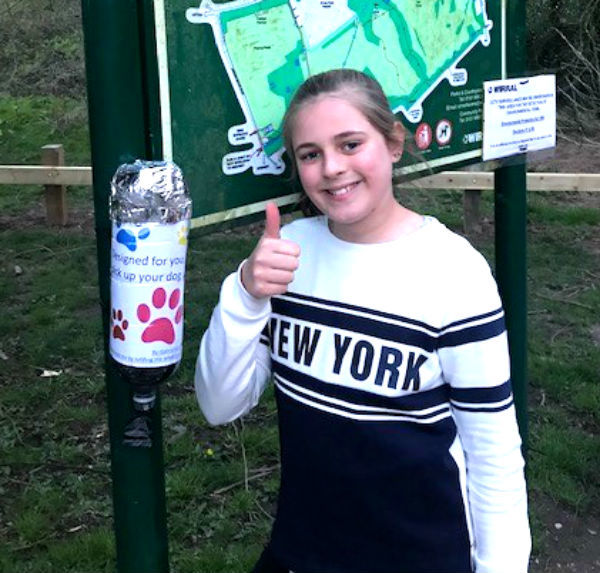Gabriella Holdgate pictured with one of the doggy bag dispensers in Arrowe Country Park. Picture courtesy of Julie Alexander-Holdgate