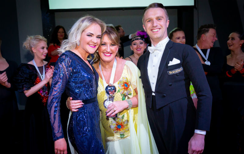 Victoria Bennett from Cadmans dance centre is pictured with 'Strictly' contest winner Emma Vernon with her dance partner Callam Thomson