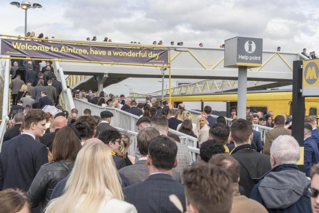 Racegoers arriving at Aintree train station on Friday's Ladies Day event