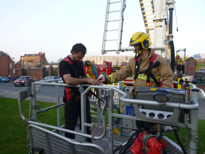 Blue the Parrot is rescued by firefighters. Picture: Tyne and Wear Fire and Rescue